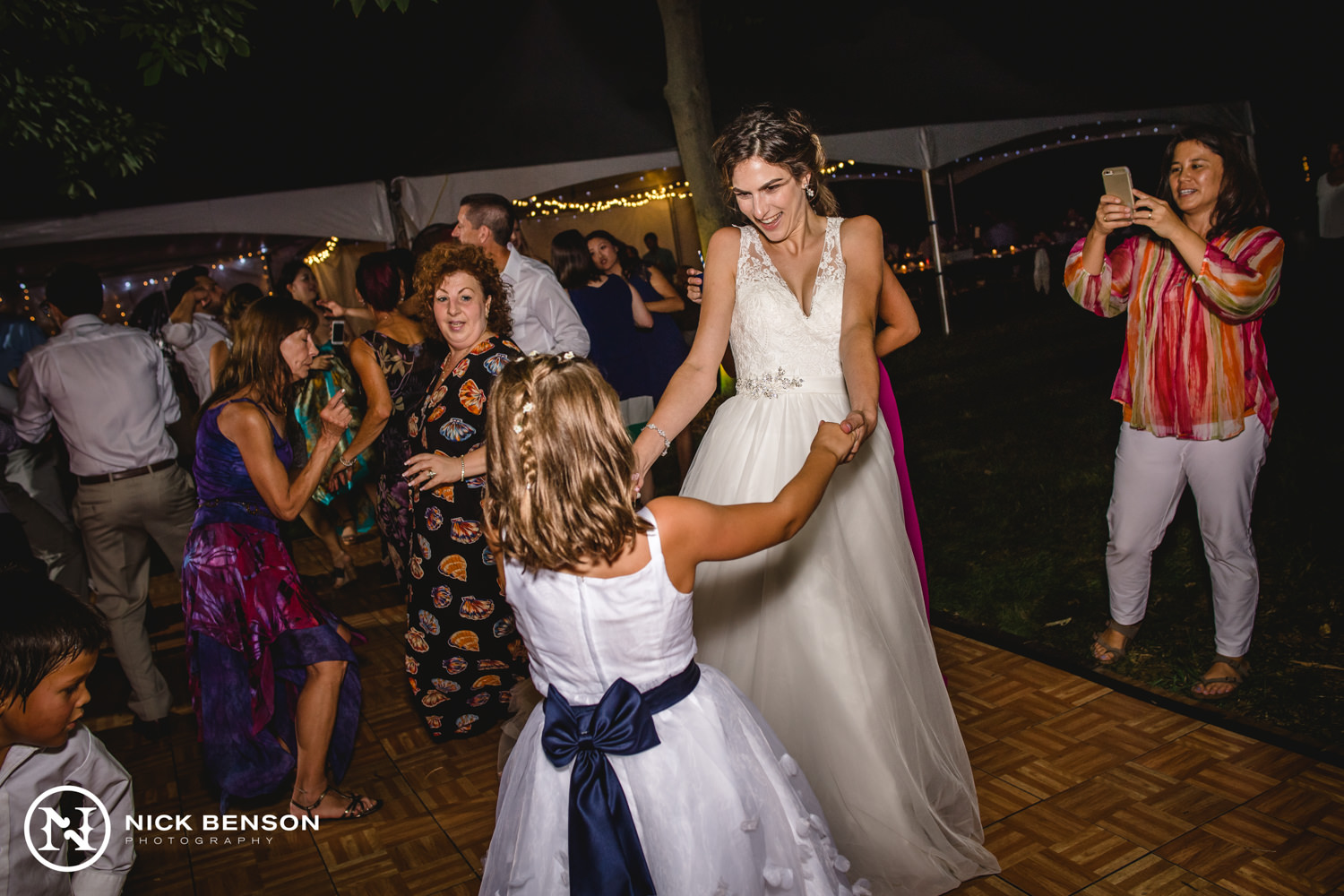 bride dancing, backyard wedding reception