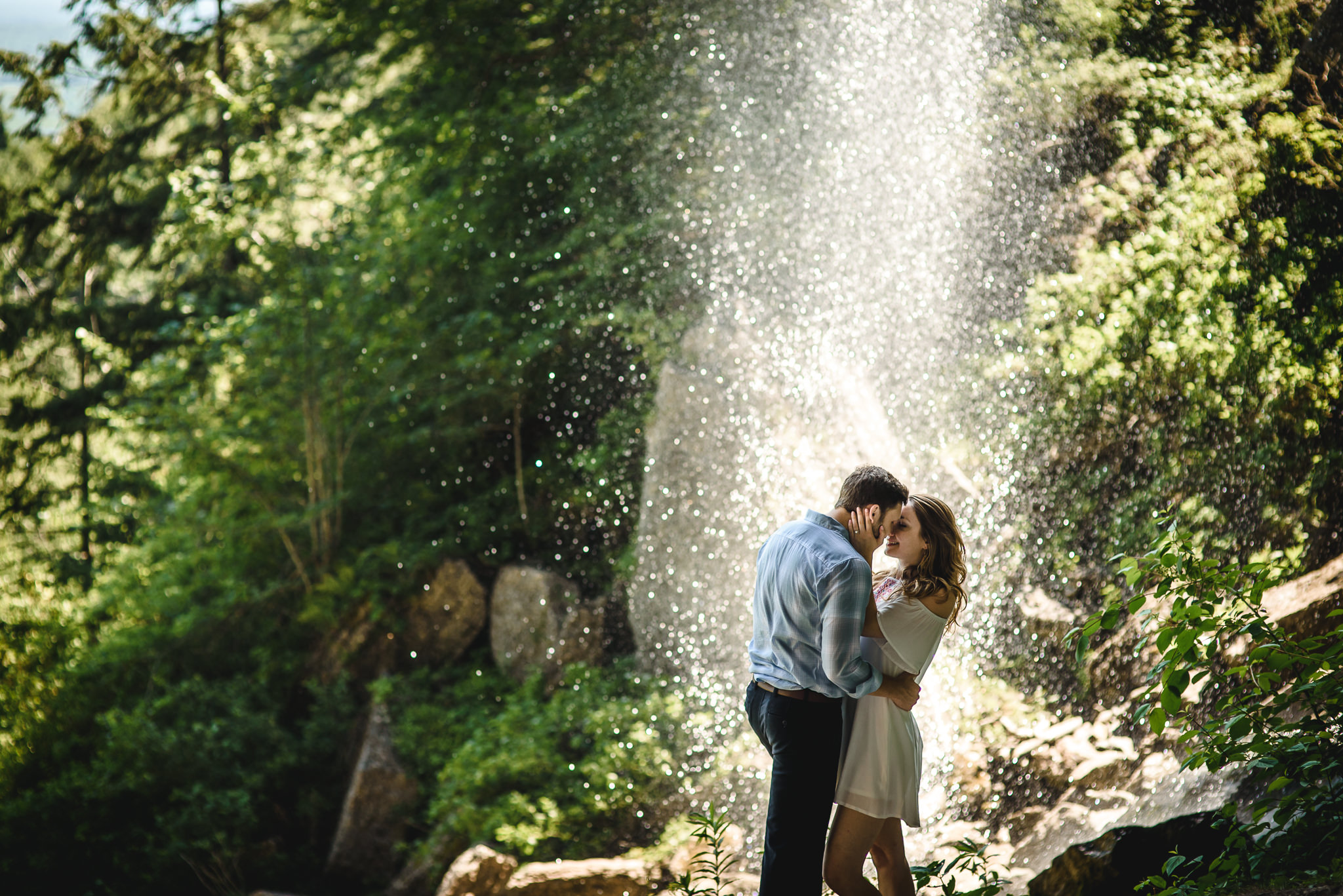 couple kissing under waterfall, Nick Benson Photography